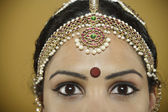 Indian woman wearing a bindi on her forehead — Stock Photo