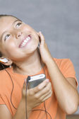 Close up of girl listening to music with headset — Stock Photo