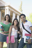 Students smiling for the camera — Stock Photo