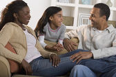 Family together in living room — Stock Photo