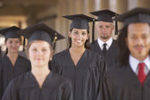College students in cap and gown — Stok fotoğraf