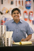 Male employee smiling for the camera — Stock Photo