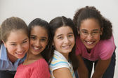 Portrait of four girls smiling — Stock Photo