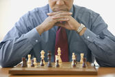Man concentrating on chess game — Stock Photo