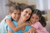 Portrait of mother with two daughters — Stock Photo