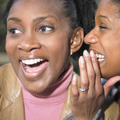 Friends laughing and sharing — Stock Photo
