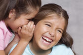 Two girls whispering — Stock Photo