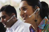 Young woman talking on a headset — Stock Photo