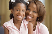 Mother and daughter smiling for the camera — Stock Photo