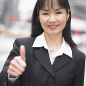 Businesswoman giving thumbs up — Stock Photo