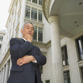 Low angle view of senior Asian businessman posing — Stock Photo