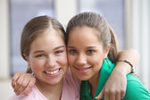 Portrait of two teenage girls smiling — Stock Photo