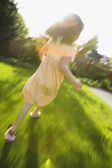 Girl running in blurred motion — Stock Photo