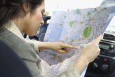Profile of woman looking at map in car — Stock Photo