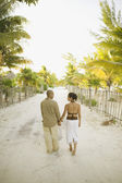 Couple walking hand in hand — Stock Photo