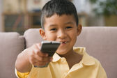 Young boy using a remote control — Stock Photo