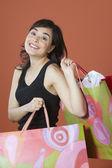Portrét ženy, nošení nákupní tašky — Stock fotografie
