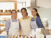 Portrait of three woman in bakery — Stock Photo