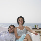Young couple lounging in chair — Stock Photo