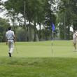Couple playing golf - Stockfoto