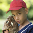Portrait of boy in baseball cap with mitt — Stock Photo