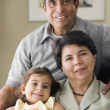 Portrait of grandparents with granddaughter — Stock Photo