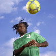 Male soccer player headering the ball — Stock Photo