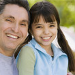 Hispanic father and daughter smiling — Stock Photo