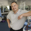 Physical trainer posing for the camera in a gym — Stock Photo