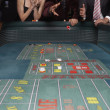 Stock Photo: Mrolling dice at gambling table in casino