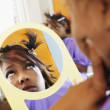 Young woman examining herself in the mirror — Foto Stock