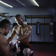 Coach bandaging male boxer's hands — Stockfoto
