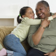 Senior woman hugging her granddaughter — Stock Photo #23242992