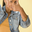 Studio shot of a female Dominican teenager framing her face with her fingers — Stockfoto