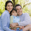 Hispanic family hugging outdoors — Stock Photo