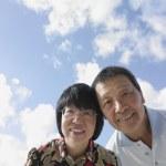 Close up of senior Asian couple outdoors — Stock Photo #23243300