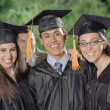 Graduates smiling for the camera - Stock Photo