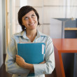 Businesswoman carrying a folder — Stock Photo