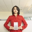Businesswoman holding a calculator - Stock Photo