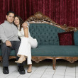 Couple sitting on an antique sofa — Stock Photo
