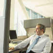 Businessman using a headset at his desk — Stock Photo #23243584