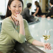 Woman at bar with glass of wine — Stock Photo