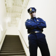 Security guard standing by staircase — Stock Photo
