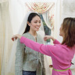 Stock Photo: Young womwearing veil in bridal boutique