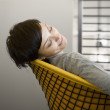 Businesswoman asleep in her chair - Stock Photo