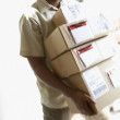 African man carrying packages — Stock Photo