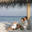 Couple relaxing at the beach — Stock Photo