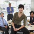 Group of businesspeople smiling in office — Stock Photo