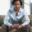 African American businesswoman sitting on sofa — Stock Photo