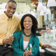 African American couple smiling at bar — Stok fotoğraf